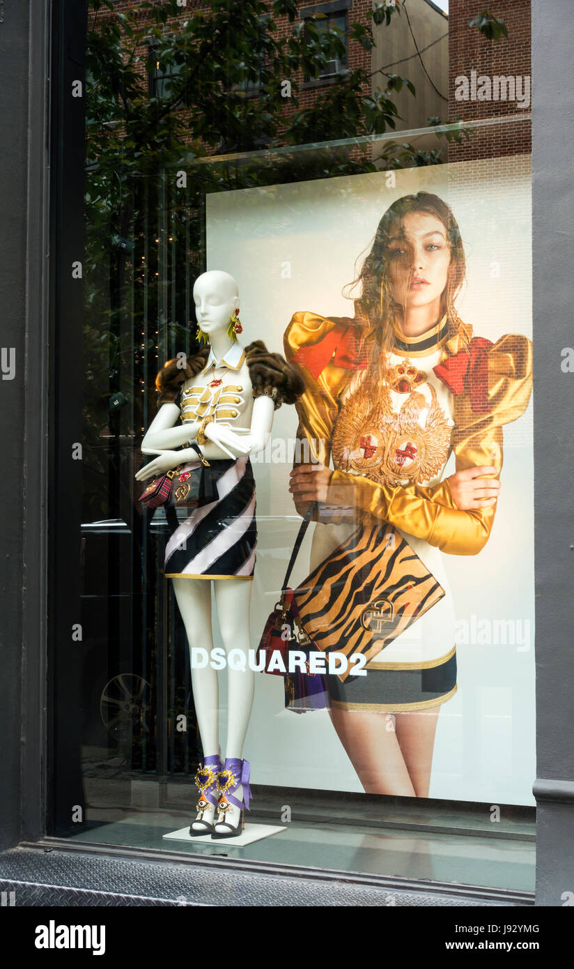 Dsqyared2 window display in SoHo shows a manikin and a giant photo of a model dressed in their boutique fashion - Stock Image