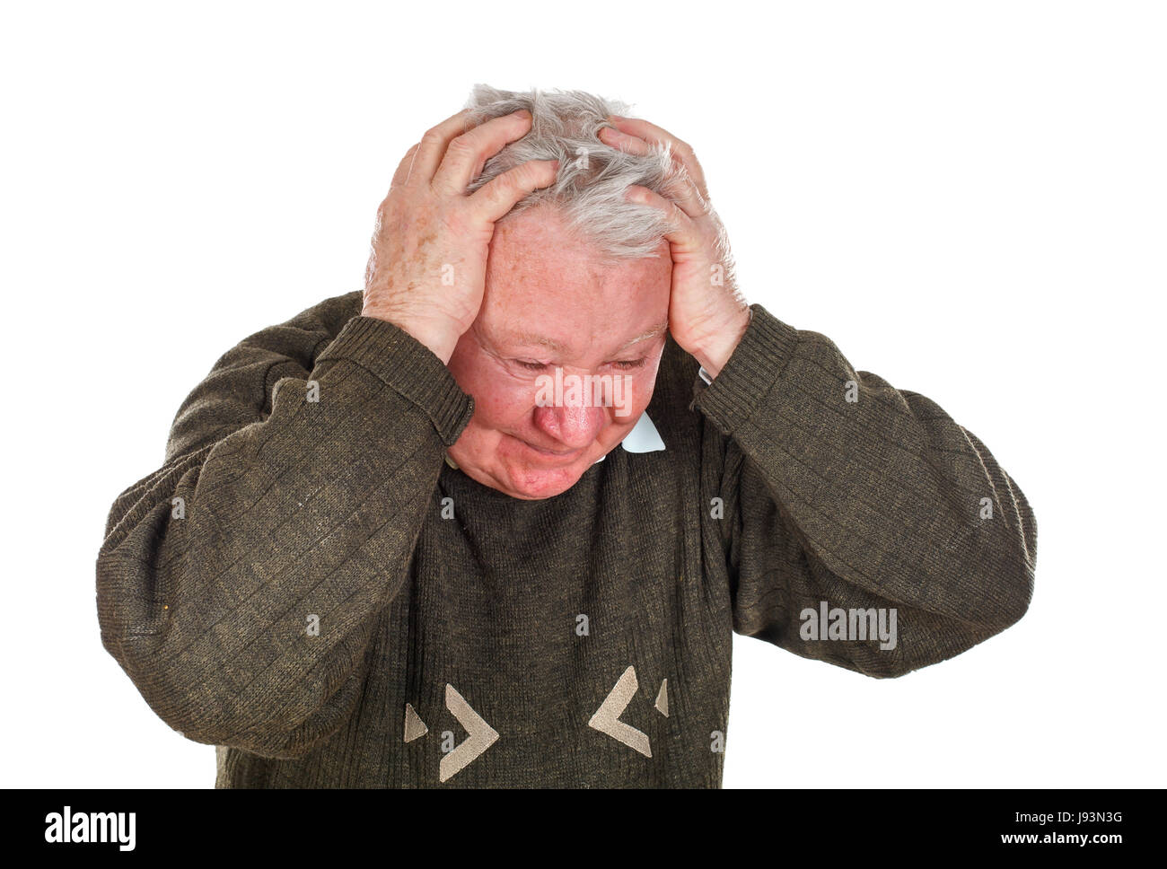 Picture of an old man having a serious headache - isolated background - Stock Image