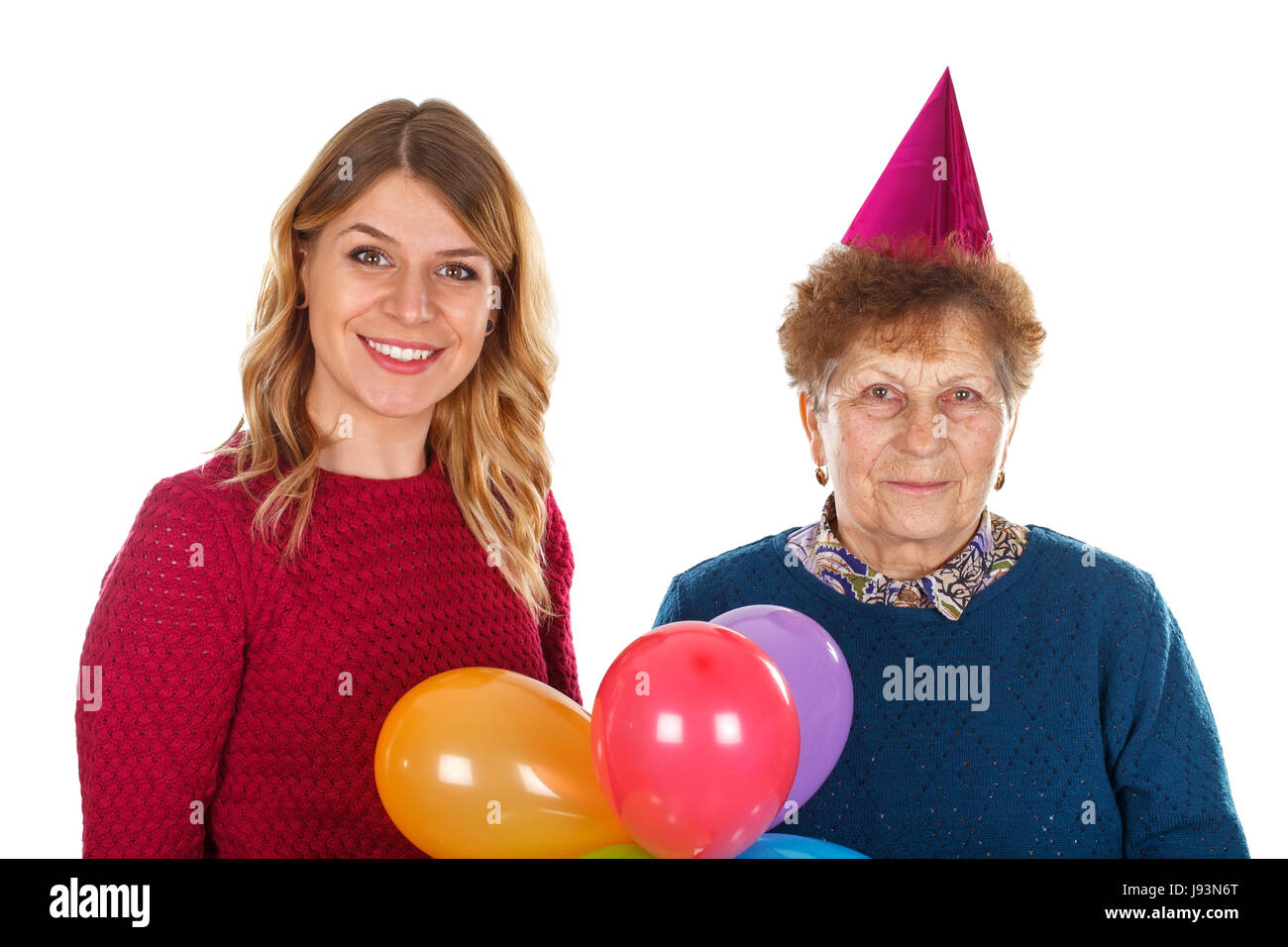 Picture of an eldery woman celebrating birthday with her granddaughter - Stock Image