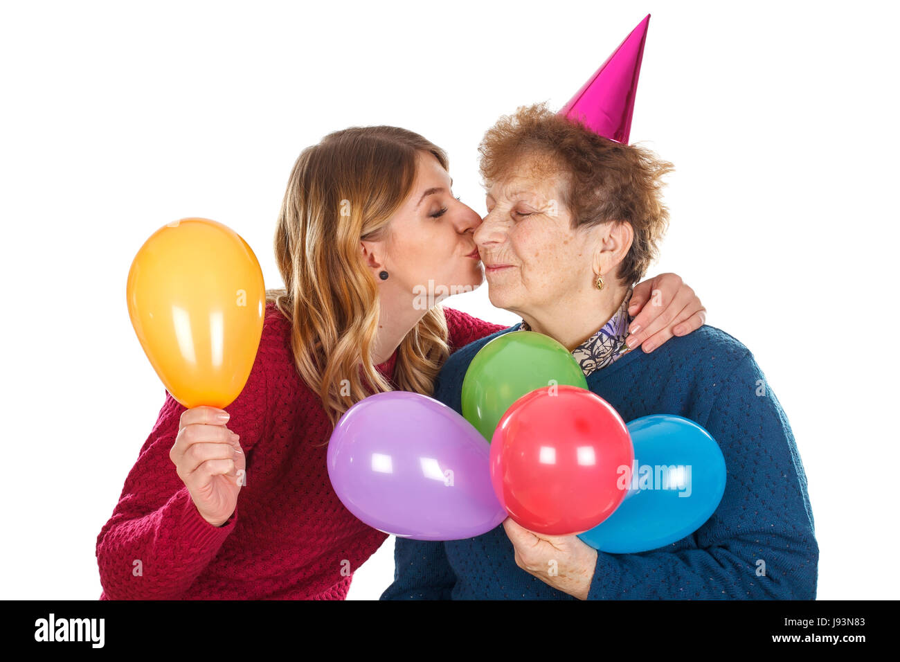 Picture of a happy old lady with her loving grandchild - isolated background - Stock Image