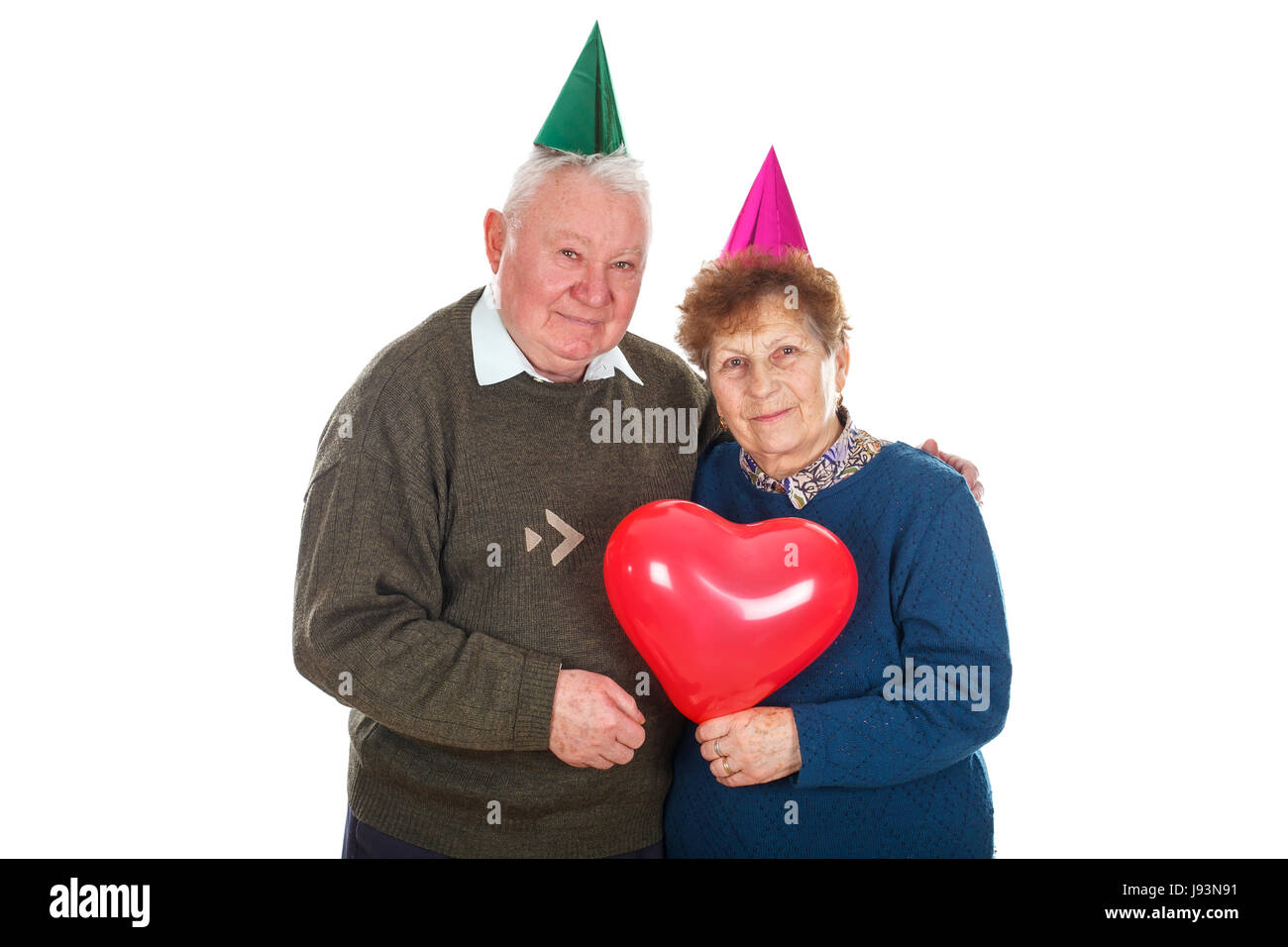 Portrait of a senior couple celebrating birthday - isolated background - Stock Image