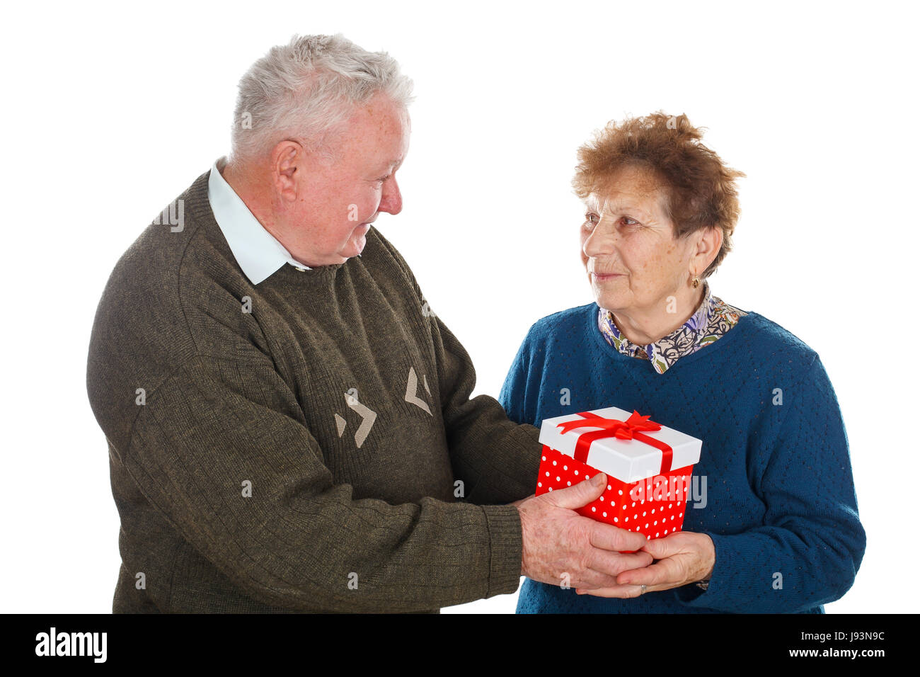 Picture of an old couple celebrating anniversary - isolated background - Stock Image