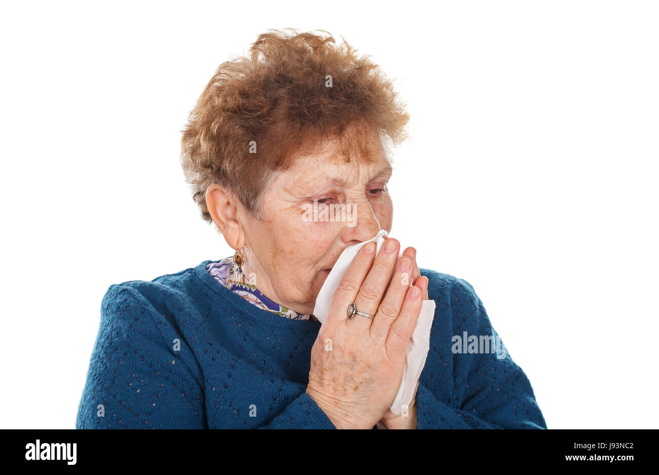 Picture of an elderly woman having a flu - isolated background Stock Photo