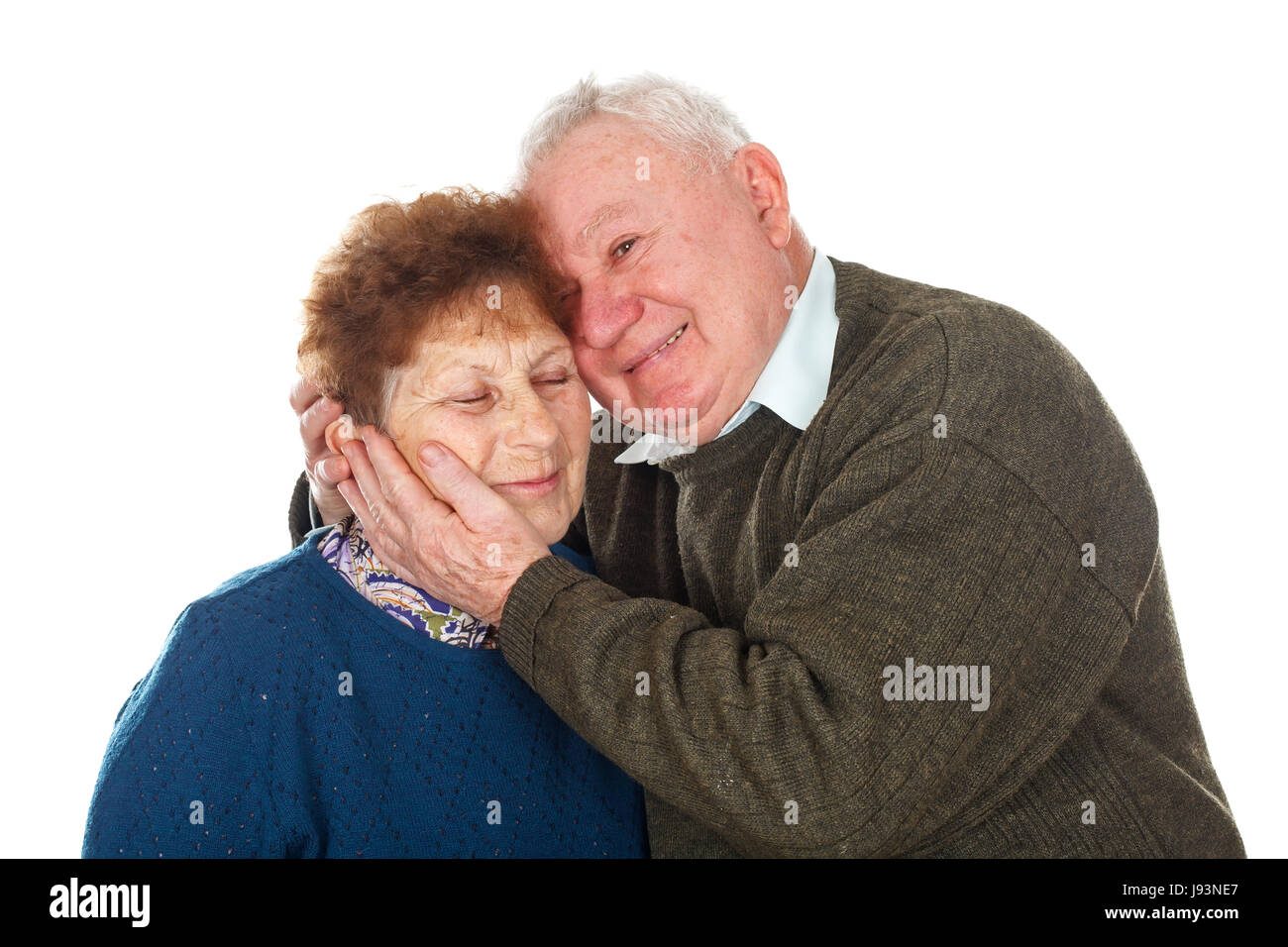 Picture of an old couple hugging each other - isolated background - Stock Image