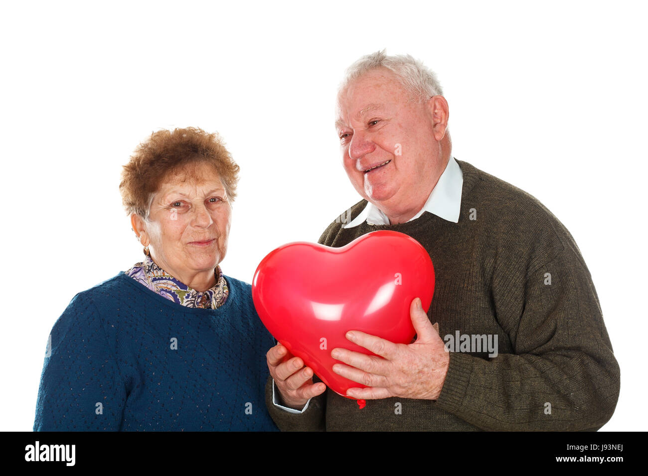 Picture of an elderly couple celebrating valentine's day - isolated background - Stock Image