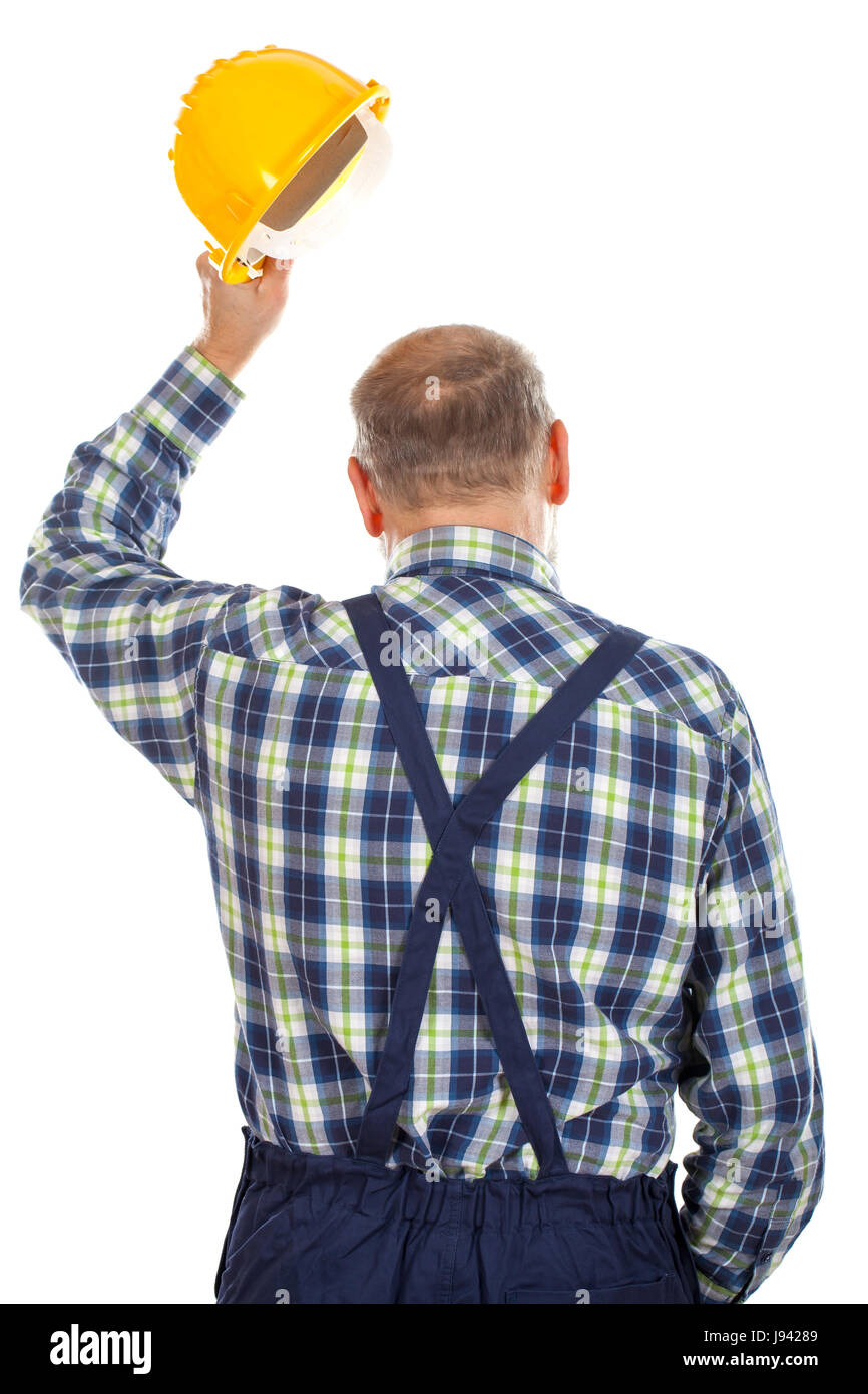 Picture of an engineer standing backward on an isolated background - Stock Image