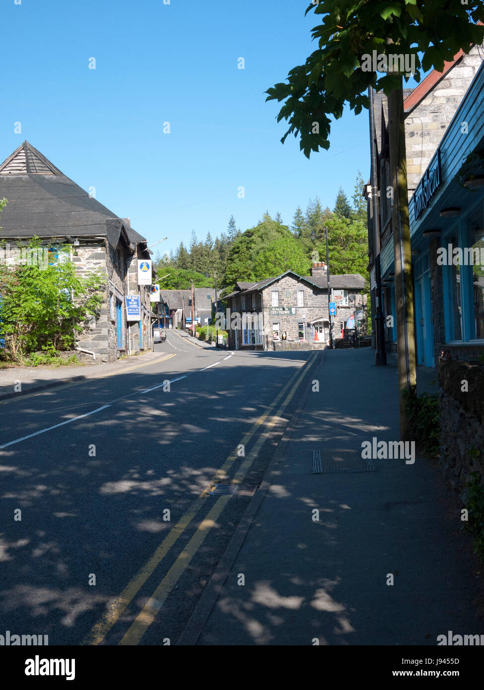 The A5 heading up through Betws-y-coed, North Wales, UK. - Stock Image