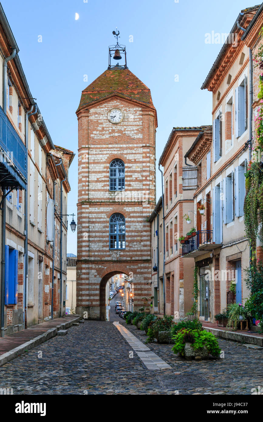 France, Tarn et Garonne, Auvillar, labelled Les Plus Beaux Villages de France (The Most beautiful Village of France), Horloge street and Clock Tower Stock Photo