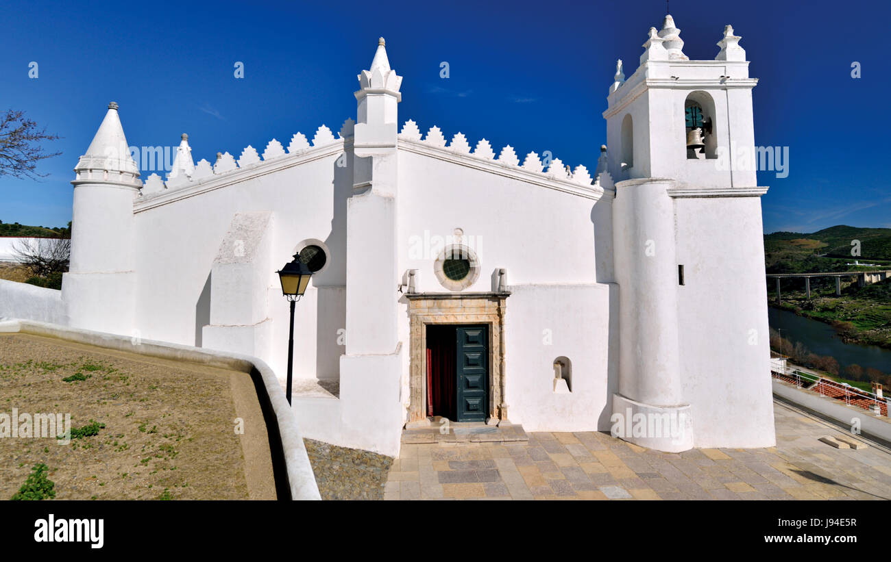 White washed church and former mosque in the Portuguese Alentejo village Mértola Stock Photo