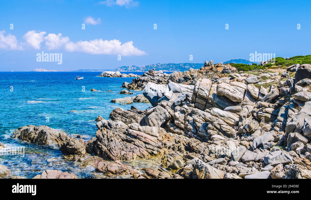 Bizarre granite rocks and amazing azure water on beautiful Sardinia island near Porto Pollo, Sargedna, Italy - Stock Image