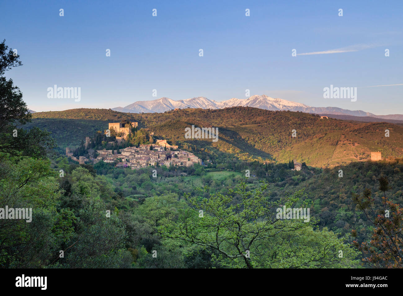 France, Pyrenees Orientales, Castelnou, labelled Les Plus Beaux Villages de France and the Snowy Canigou Peak in - Stock Image