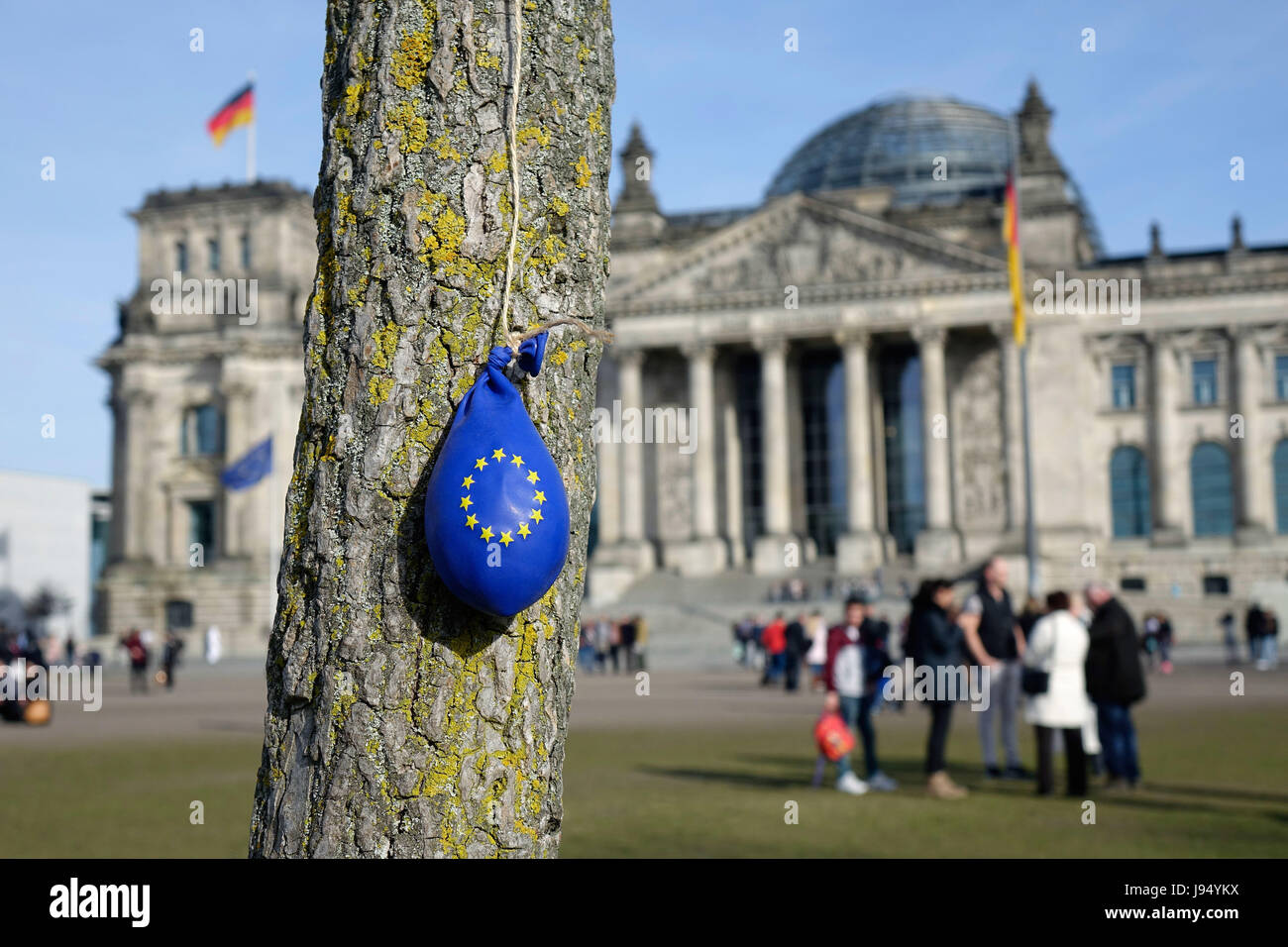 ILLUSTRATION - A deflated blue balloon emblazoned with the ring of stars that is the emblem of the European Union - Stock Image