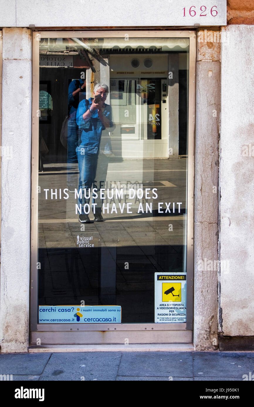 Venice,Italy,Castello. Amusing sign in display window of shop in Via Garibaldi. This Museum does not have an exit - Stock Image
