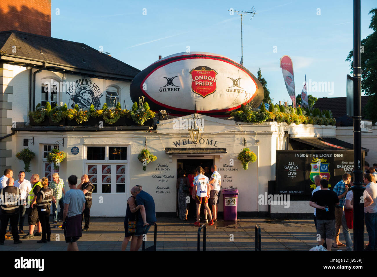 The Cabbage Patch / local pub / public house with promotional ball & rugby fan / fans. Twickenham UK; busy / - Stock Image