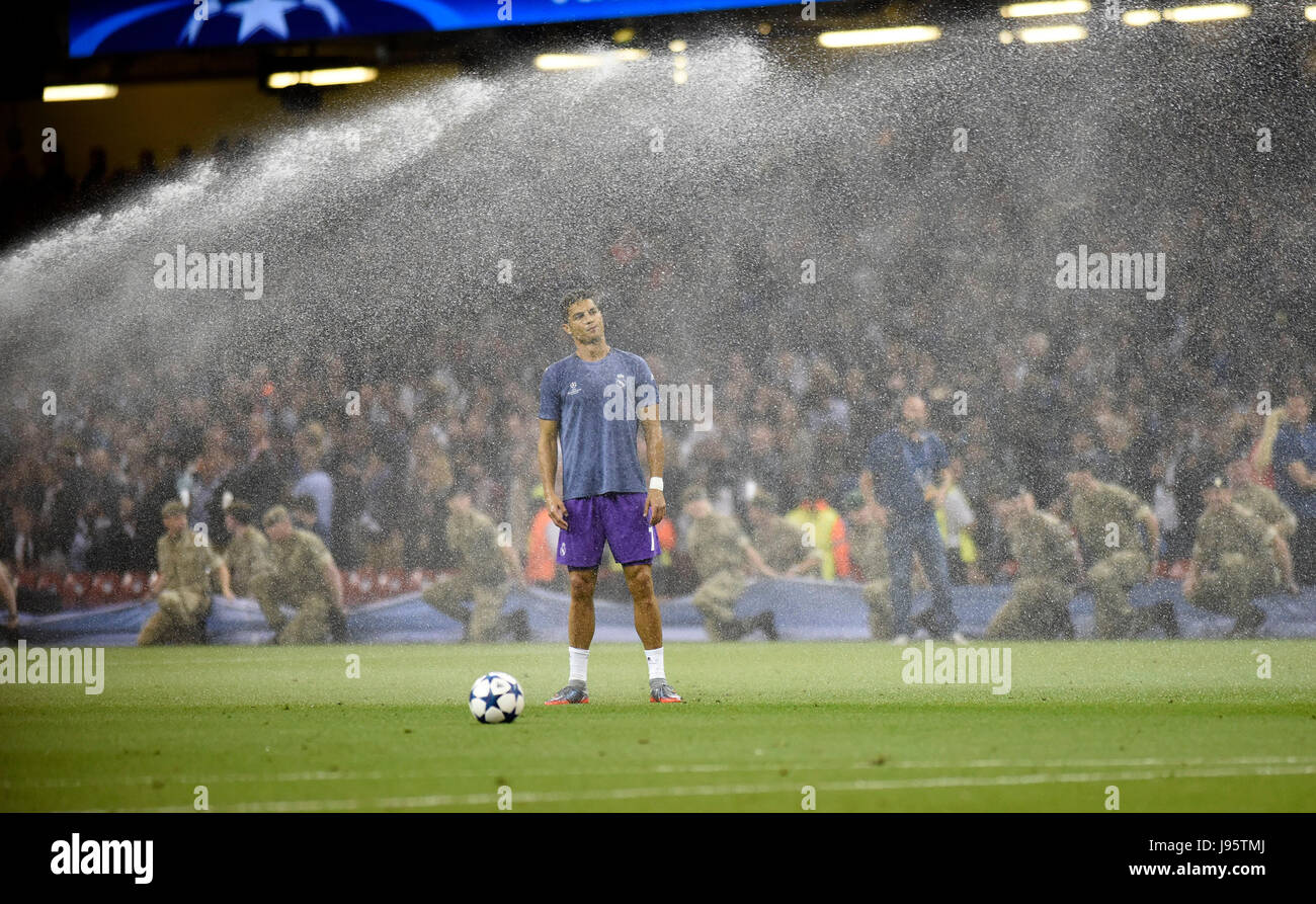 Cardiff, UK. 03rd June, 2017. Cristiano Ronaldo of Real Madrid gets a soaking during warm up ahead of the UEFA Champions - Stock Image