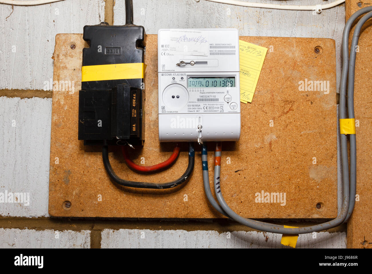 Electric meter, domestic house,UK - Stock Image