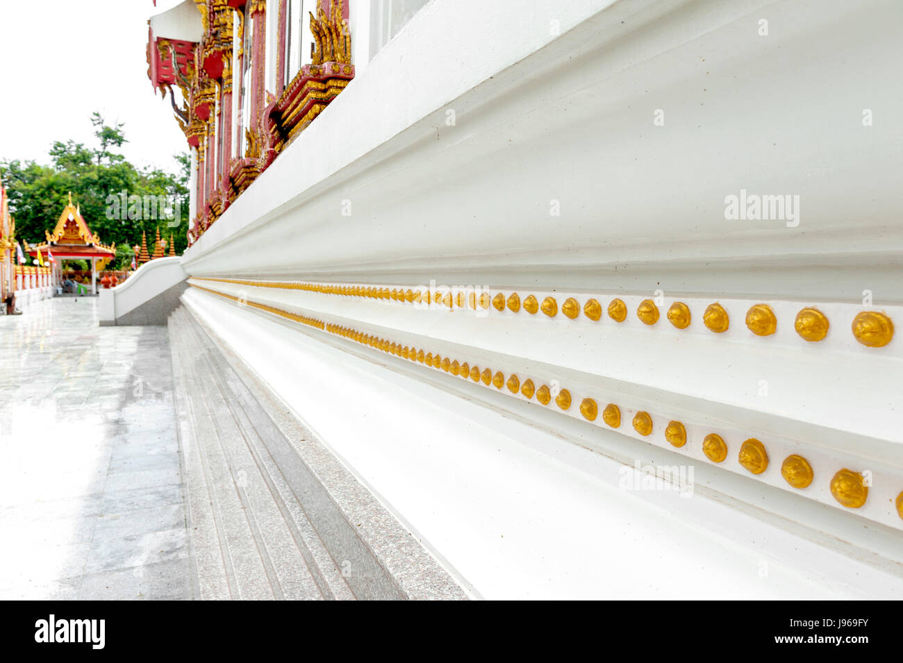 Gold decoration around Ubosot (chapel) of Wat Mahathat Temple in Yasothon, Thailand - Stock Image