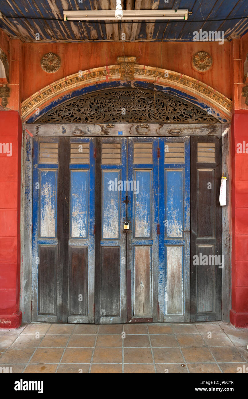 Rustic wooden door of classic Sino-Portuguese building at Ban Singha Tha, old historic area of Yasothon, Thailand - Stock Image