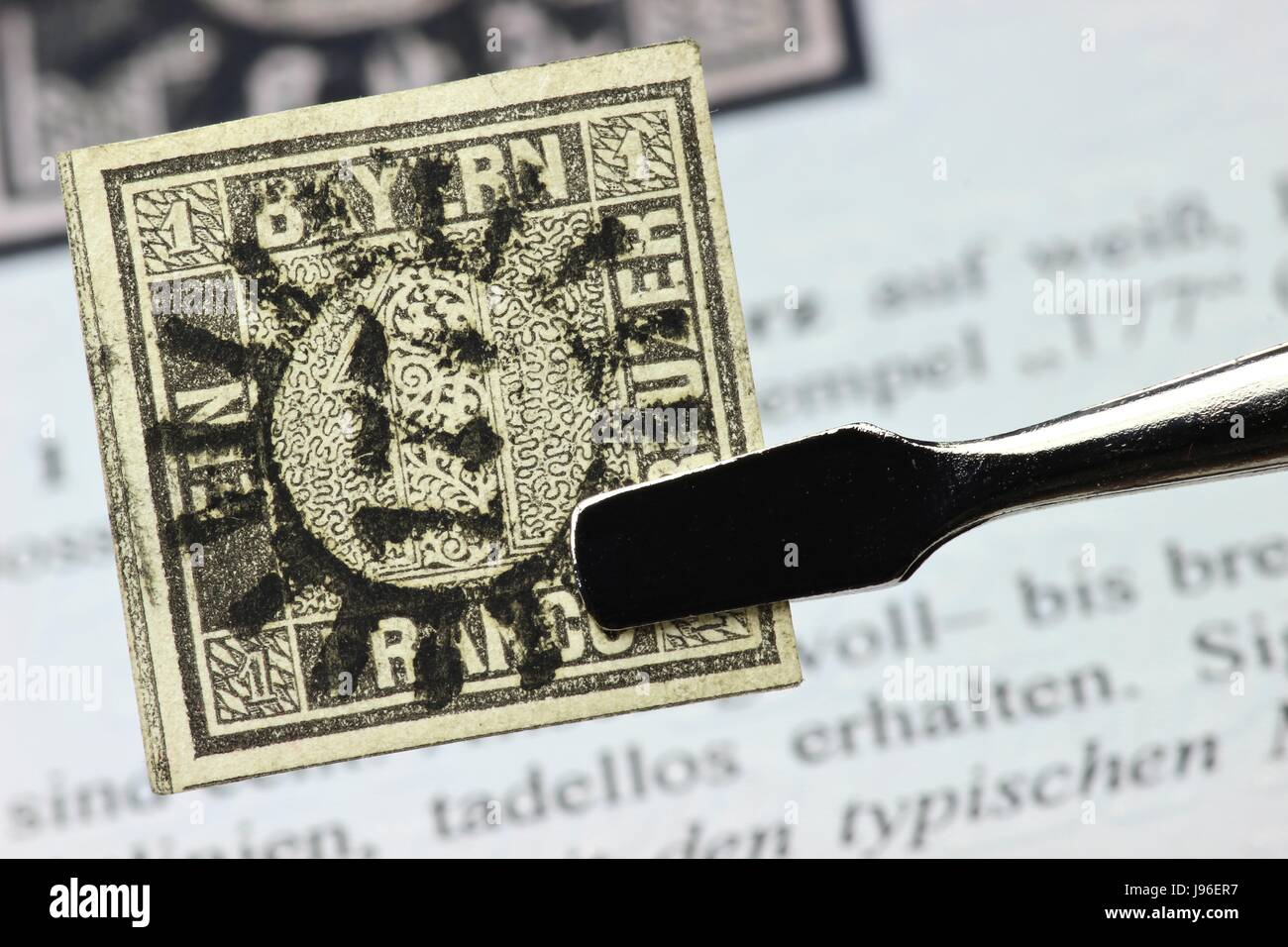 one kreuzer black, first German postage stamp issued in the Kingdom of Bavaria - Stock Image