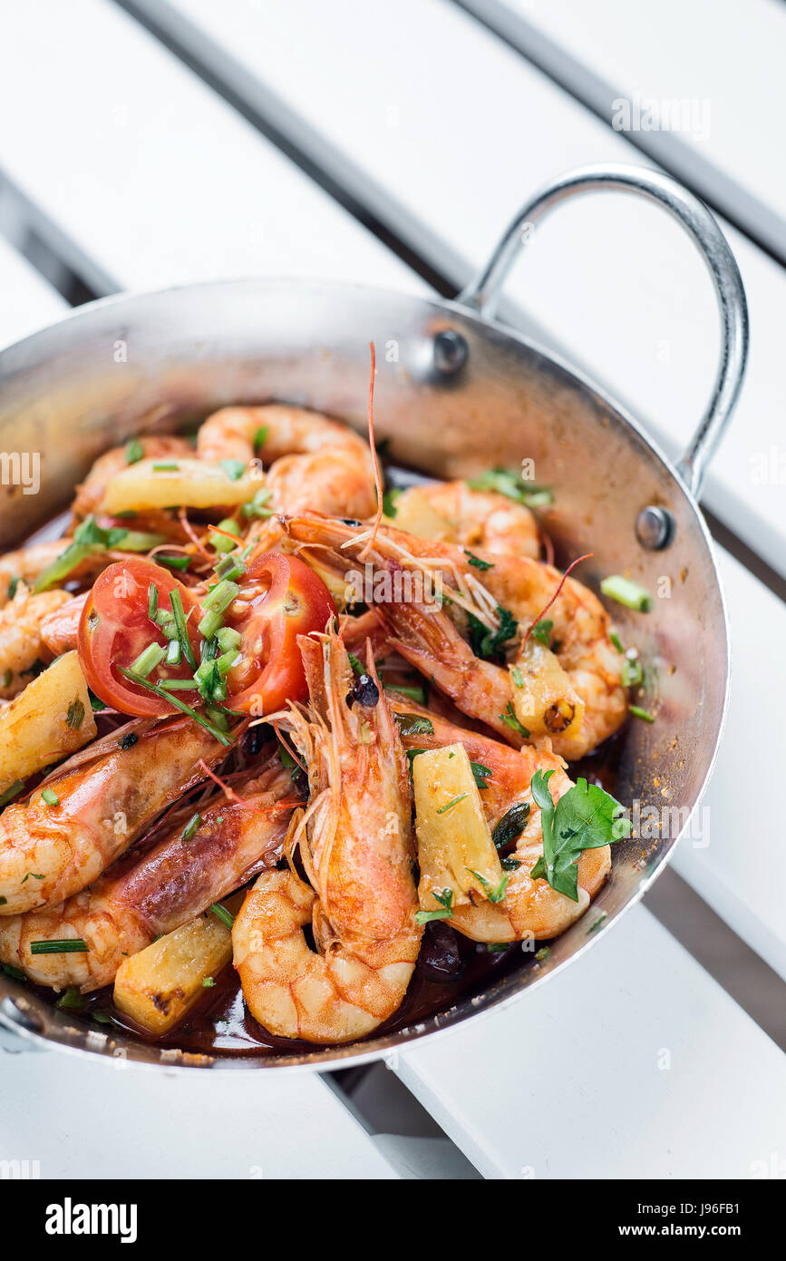 stir fry prawns in spicy asian food pineapple and herbs sauce - Stock Image