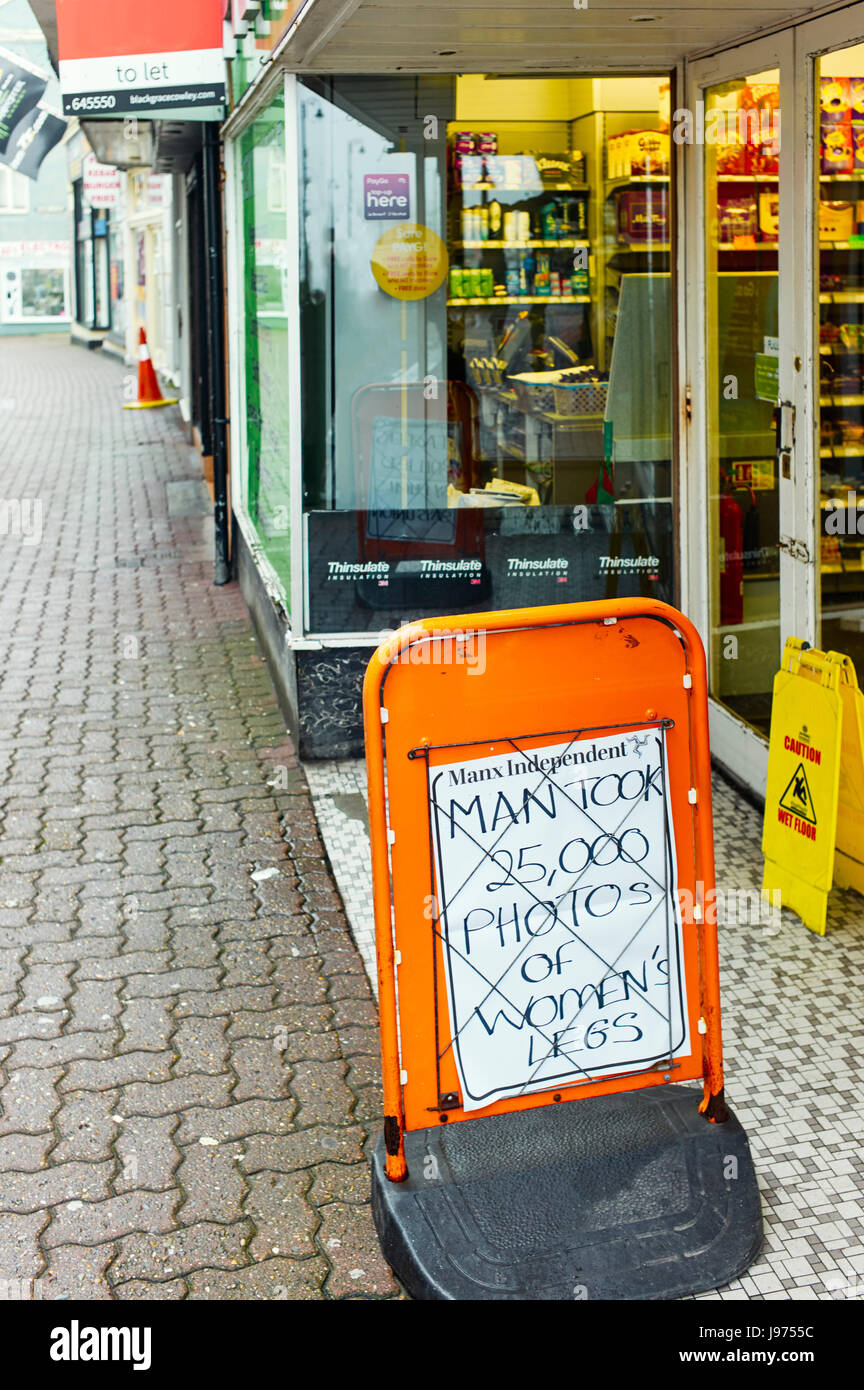 Newspaper sign outside shop man took images of womens legs - Stock Image