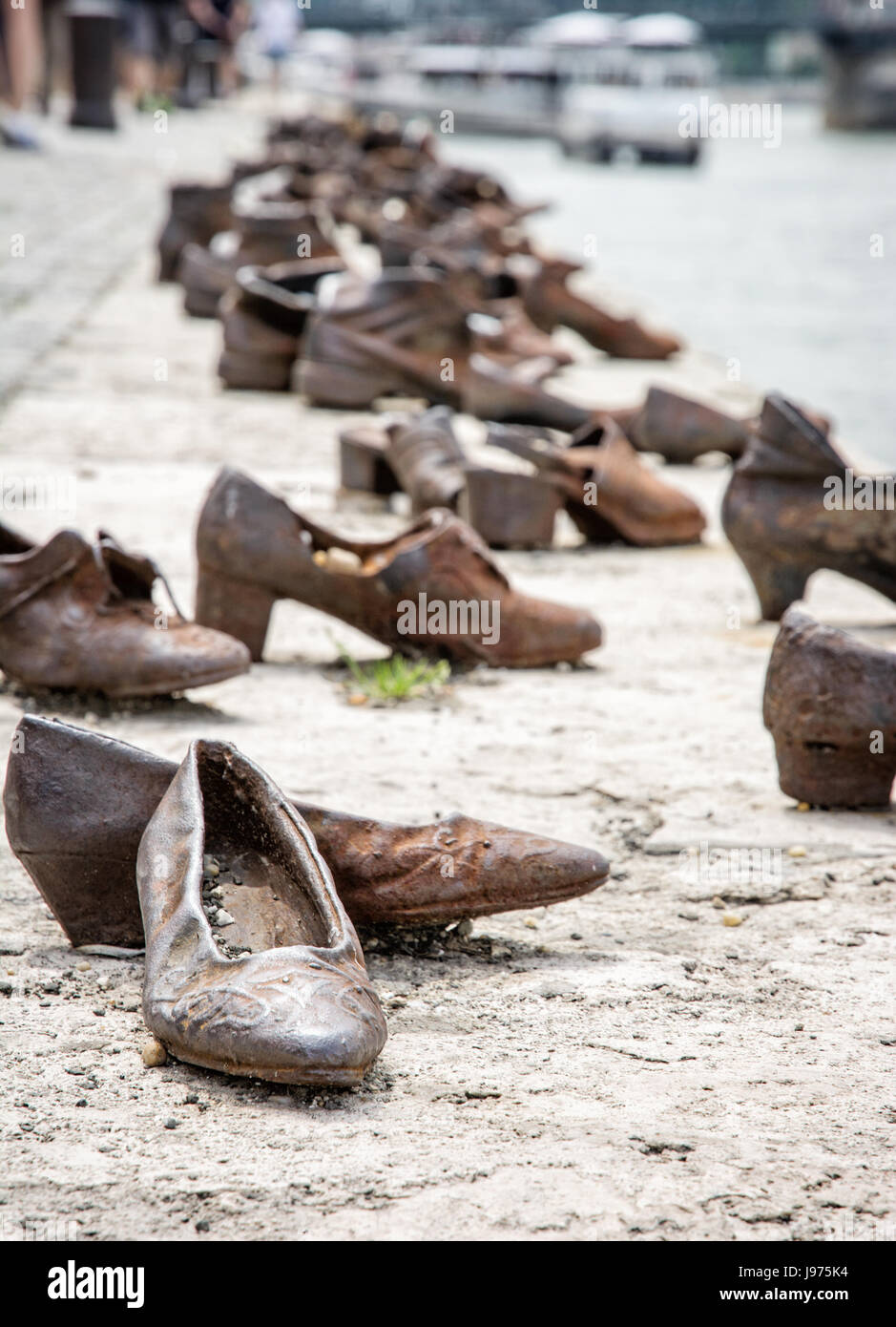 Shoes monument on the Danube bank is a memorial in Budapest, Hungary. Place of reverence. Symbolic object. - Stock Image