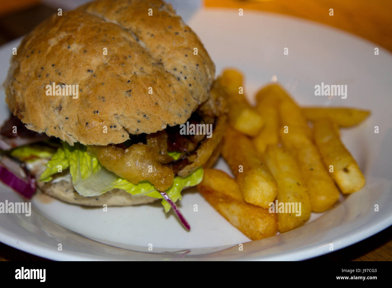 Burger and Chips on a plate - Stock Image