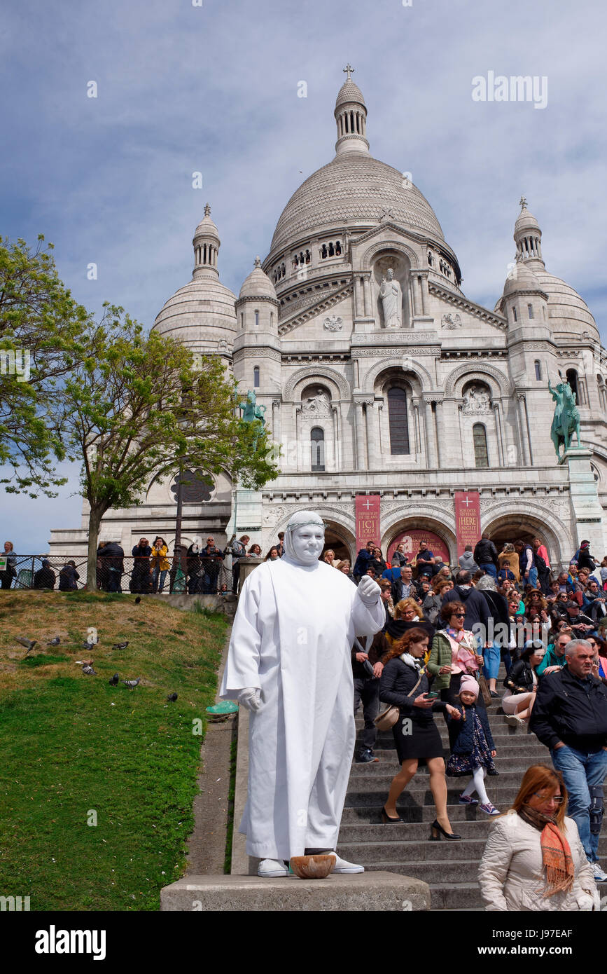 Paris,France-April 30, 2017:Tourists walk,relax and take pictures near the Basilica Sakre-Coeur.There is a living - Stock Image