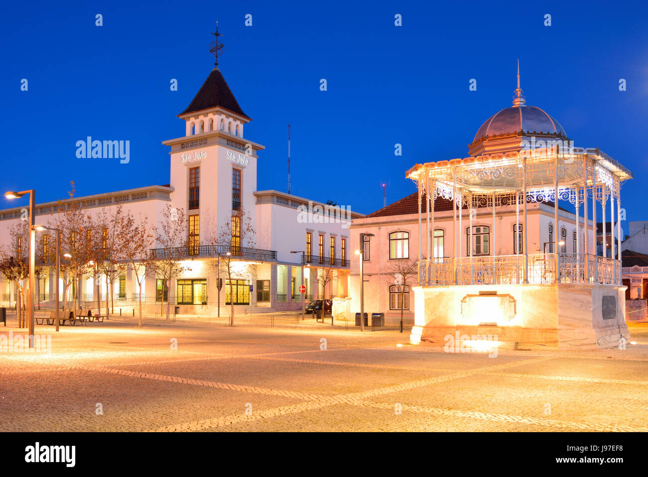 Sao Joao Cinema dating from 1952 and the Bandstand of Palmela, dated back to 1927, at dusk. Portugal - Stock Image