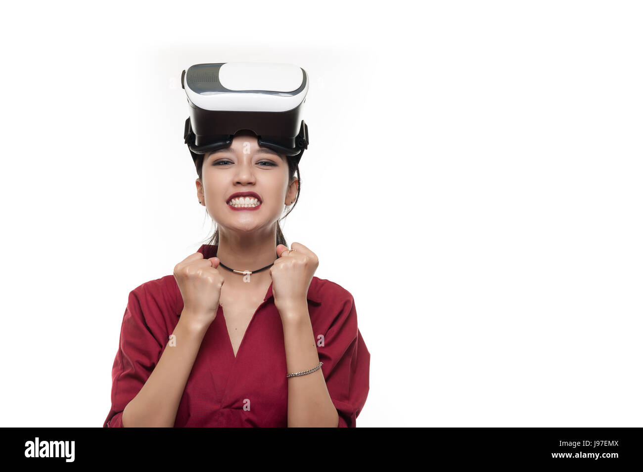 Action scene of Young attractive Asian businesswoman in red shirt ready to use VR Glasses. Virtual Reality experience for busniess activity in future  Stock Photo