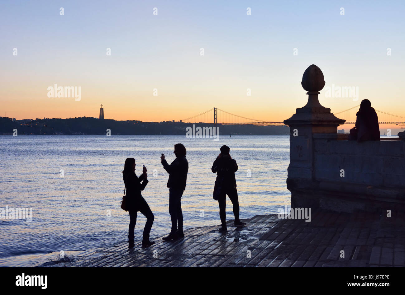 The Tagus river and Cais das Colunas at sunset. Lisbon, Portugal Stock Photo