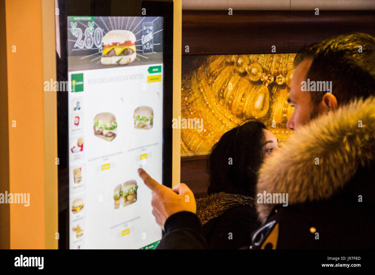McDonald's is rolling out touch-screen self-ordering kiosks, as seen here in Toulon, France in March, 2016, - Stock Image