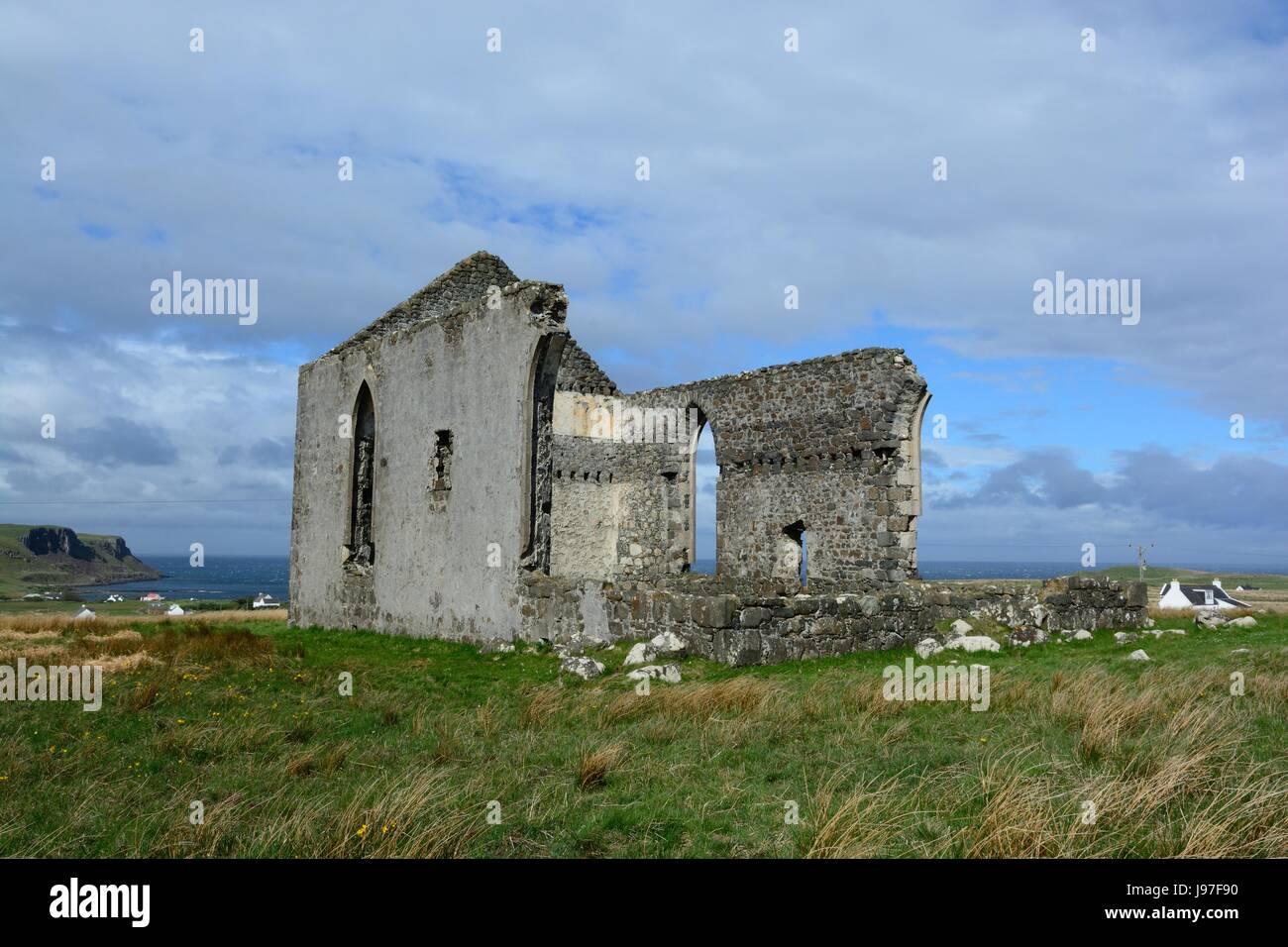 ruins of old Kilmuir church overlooking Camas Mor Bay well known landmark Kilmuir Isle of Skye Scotland UK - Stock Image