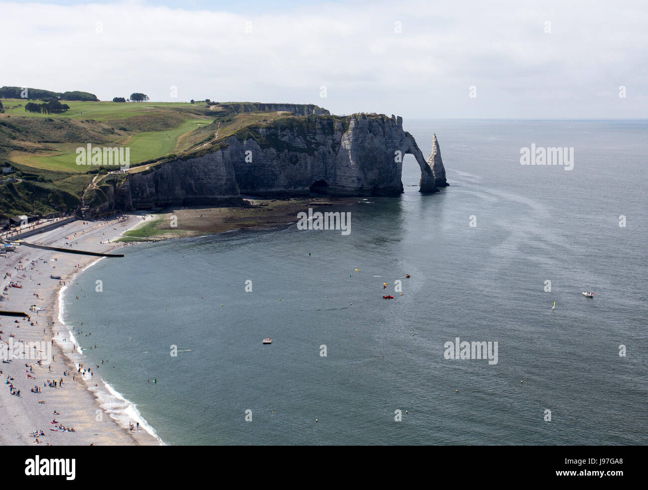 Etretat village, its bay beach and Aval cliff landmark Aerial view Normandy, France, Europe - Stock Image