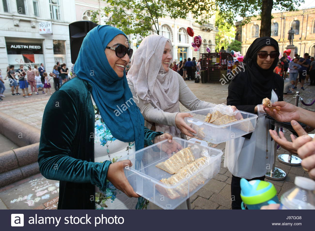 Women in St Ann's Square Manchester distribute sandwiches among people who had arrived to pay tribute to the - Stock Image