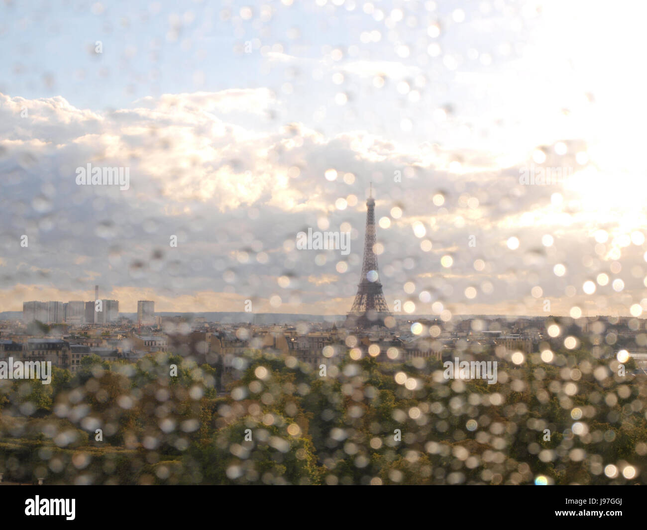 Raindrops on the window, and the Eiffel Tower in Paris, France, mainland Europe. Paris weather can be unpredictable. - Stock Image