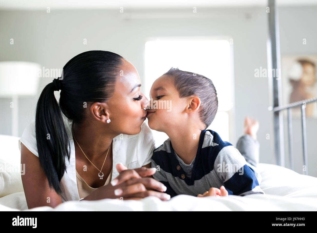 Mother kissing son (2-3) - Stock Image