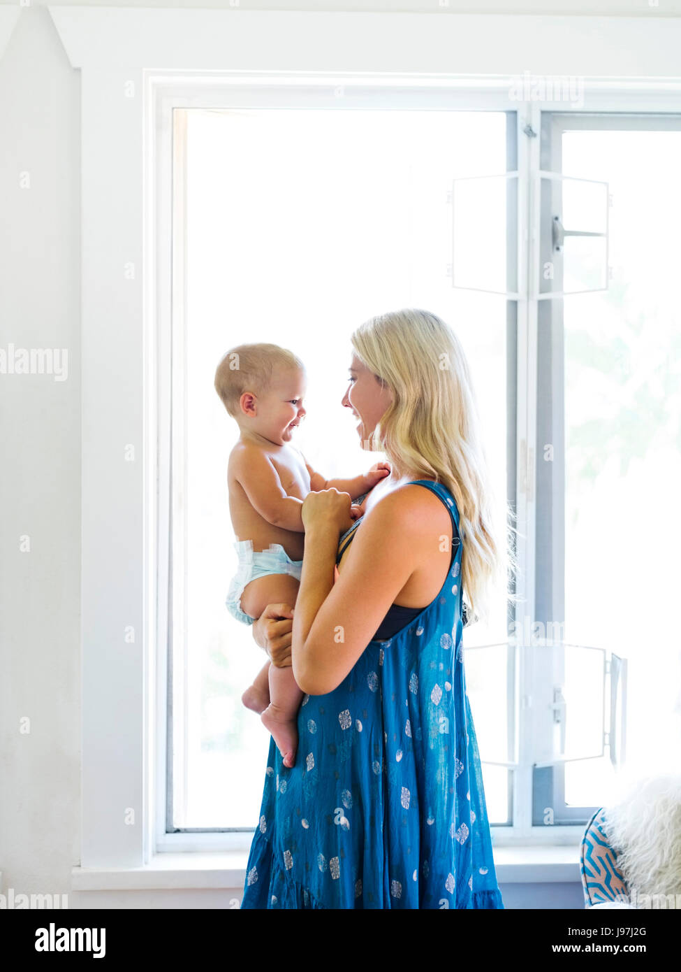 Mother holding baby boy (18-23 months) - Stock Image