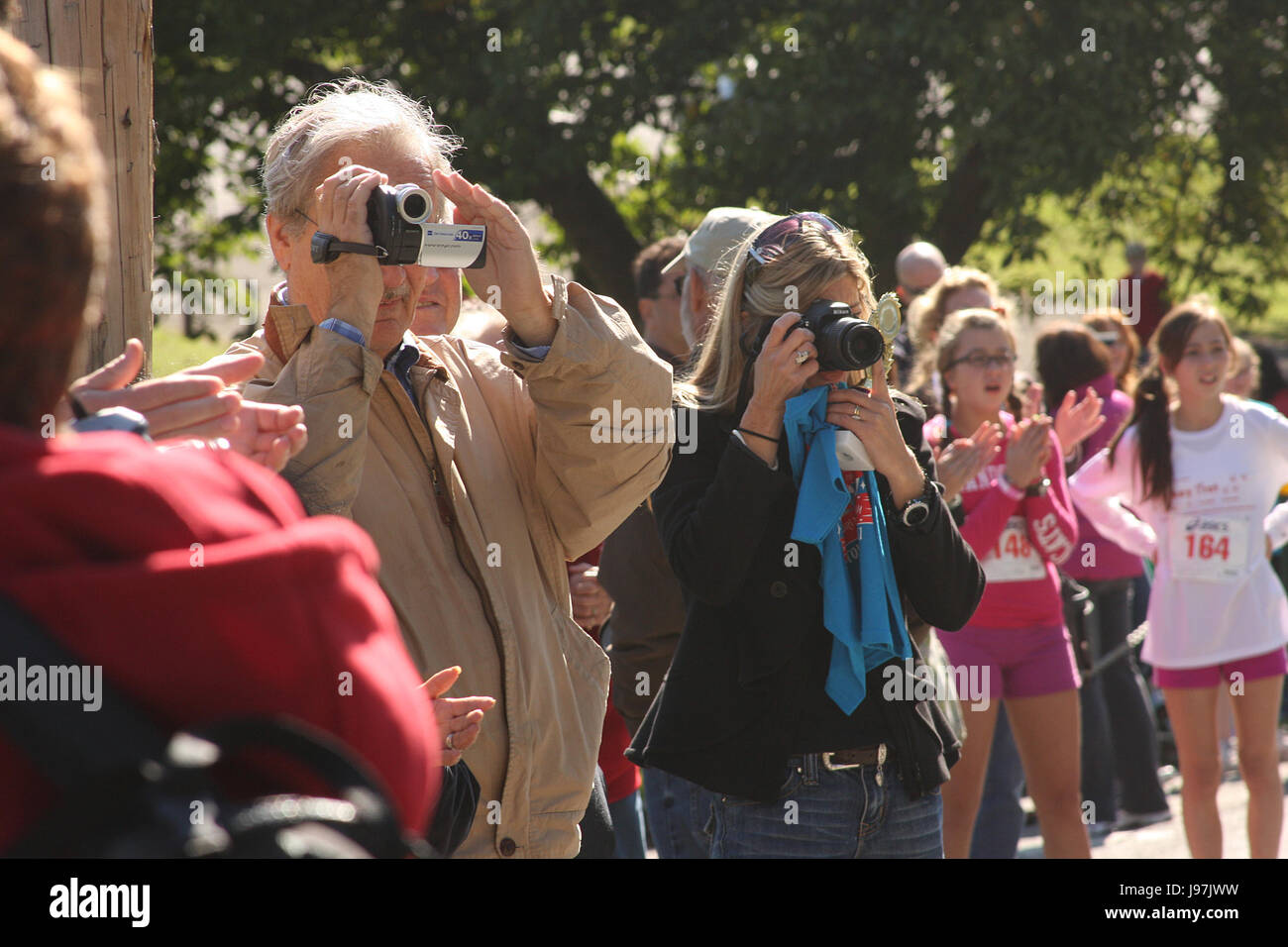 Parents taking photos and videos during sport event - Stock Image