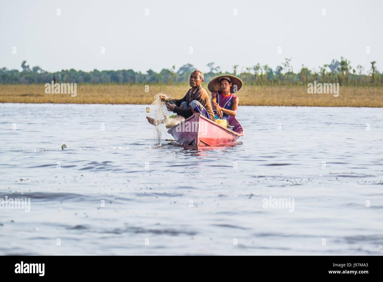 Fishermen fishing in Lake Sentarum, West Kalimantan Borneo. - Stock Image
