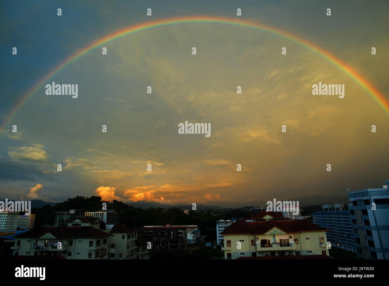 Beautiful evening rainbow over Kota Kinabalu, Sabah, Malaysia. - Stock Image