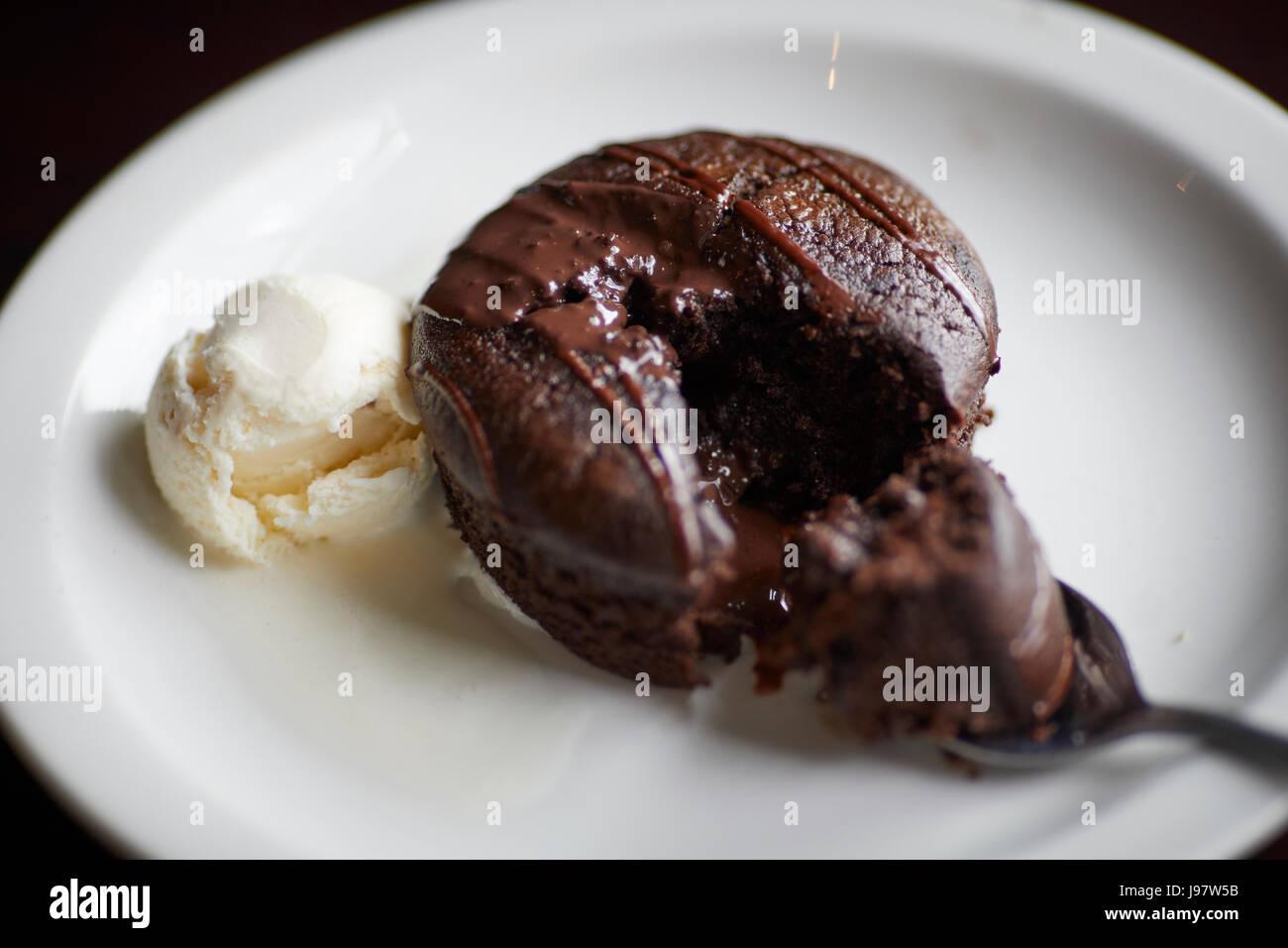 Traditional British chocolate cake with ice-cream - Stock Image