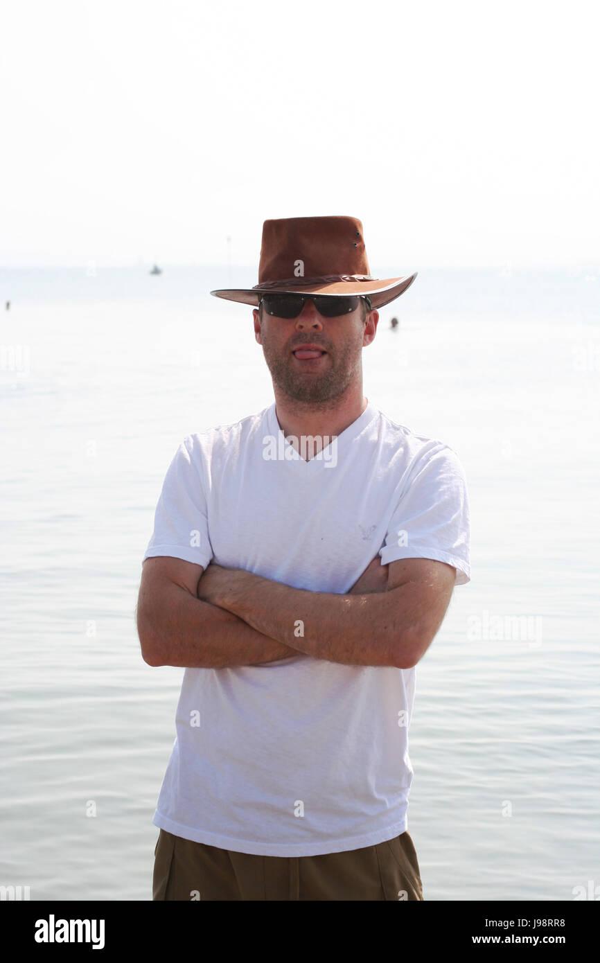 Man wearing a stetson cowboy hat at the beach in Dublin Ireland ... 5de916509f7