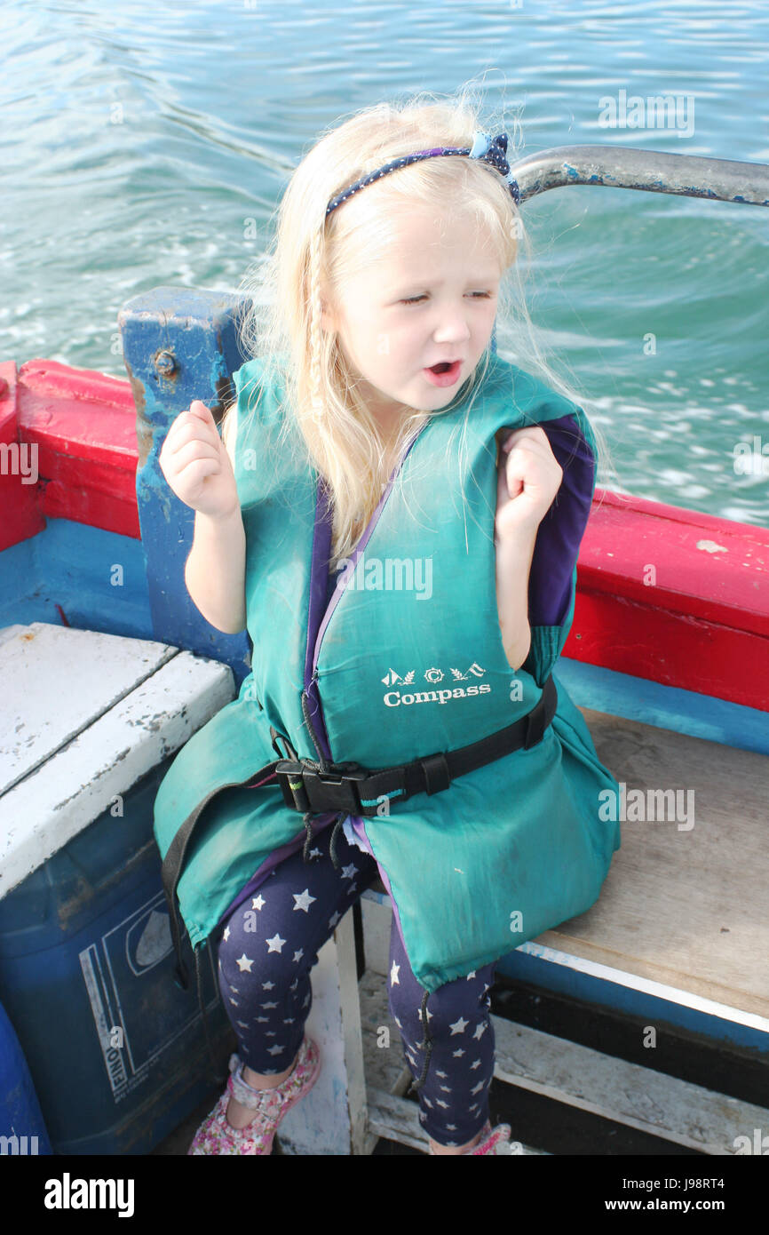 6df0242814f86 Child wearing a life jacket,having fun on a boating trip in Dublin Bay,  Ireland