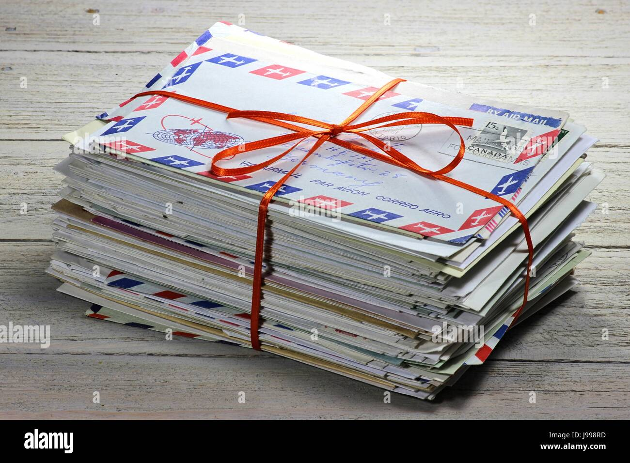 bundle of old letters on wooden background - Stock Image