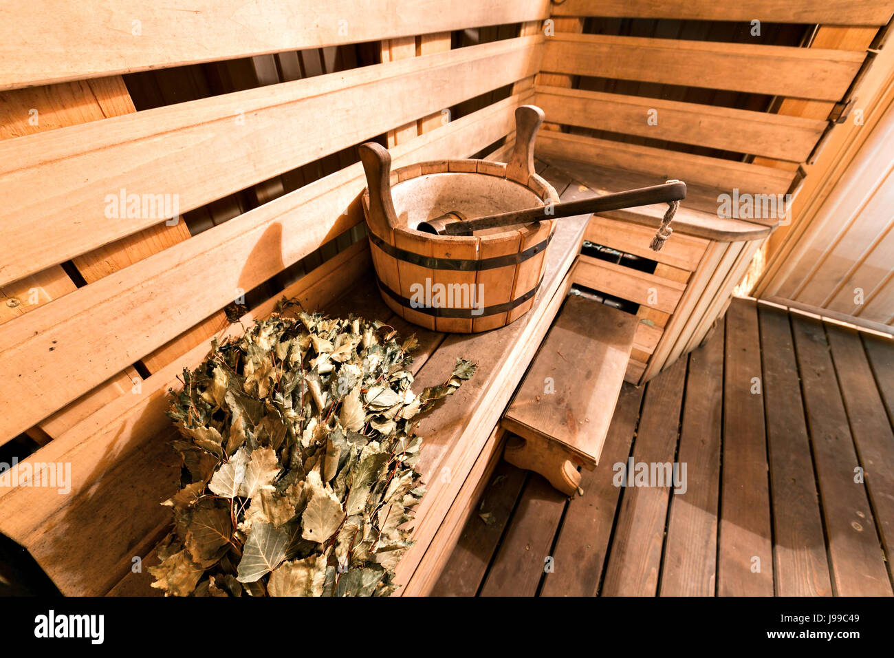 Empty wooden sauna room with ladle, bucket ready to be used - Stock Image