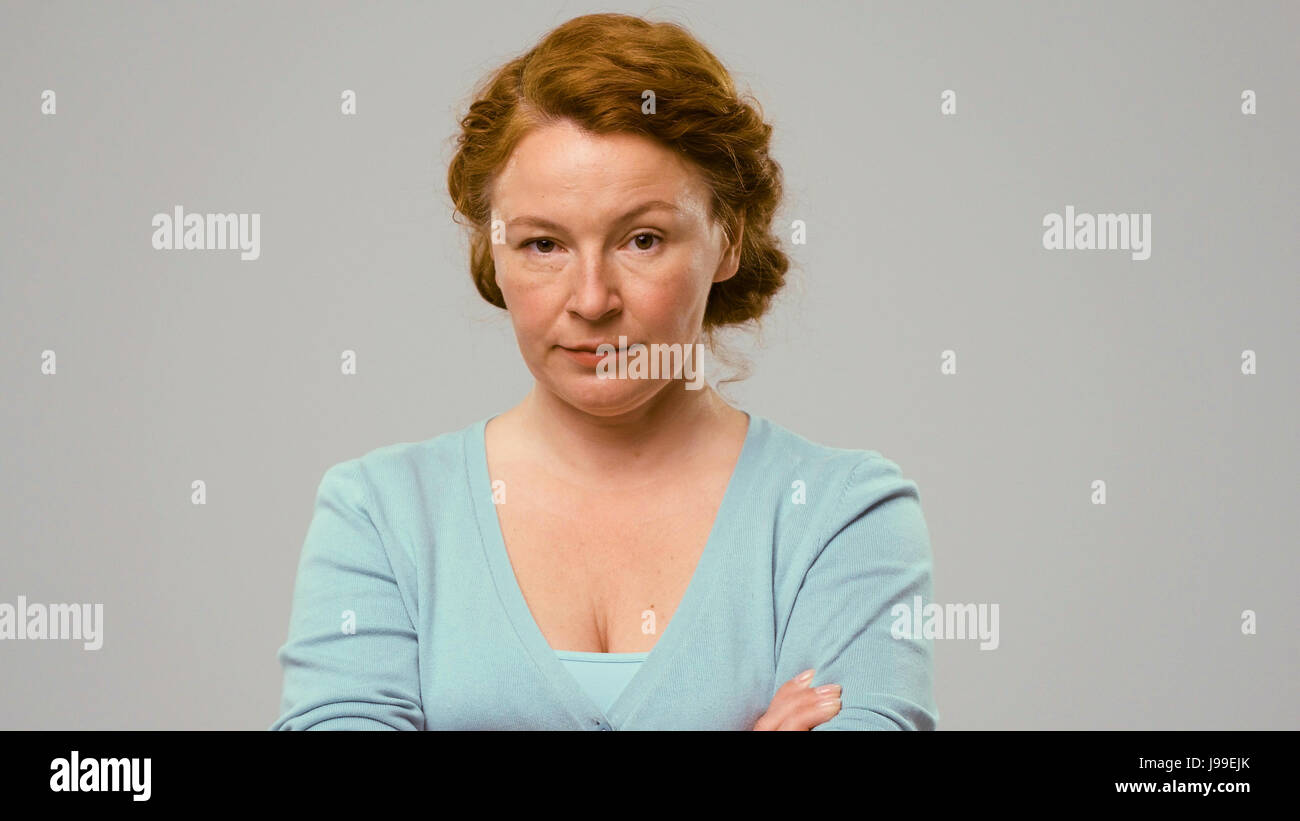Mid-aged actress shows the emoltion of doubt Stock Photo