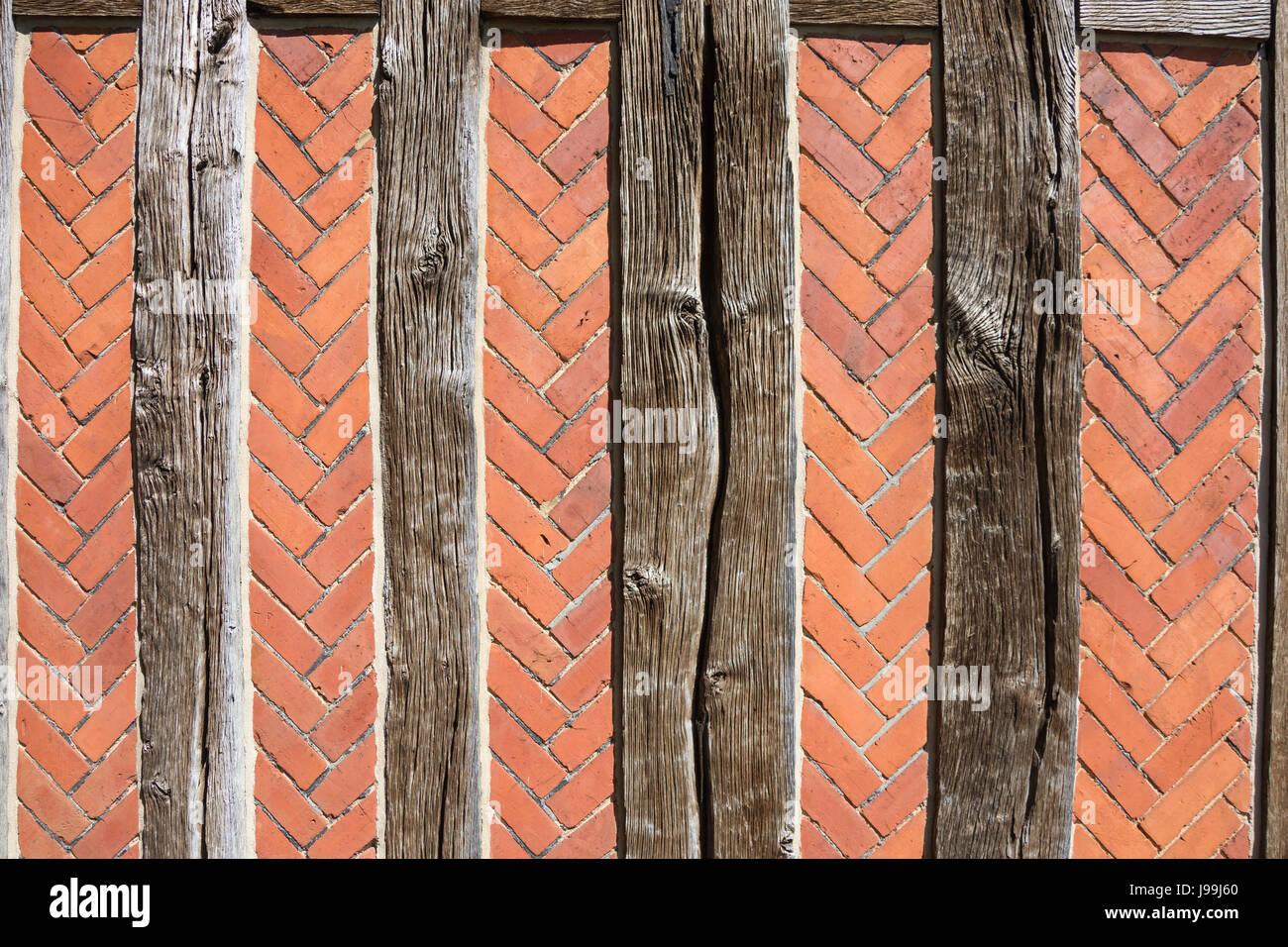 Ancient beams and brickwork on walls of St Peter's Church, Oaklands, Yateley, Hampshire, England, United Kingdom - Stock Image