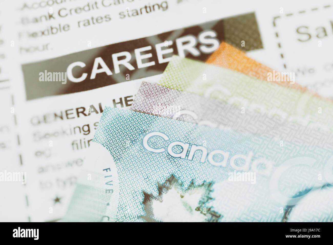 Fake careers ad and Canadian dollar, concept of business and finance - Stock Image