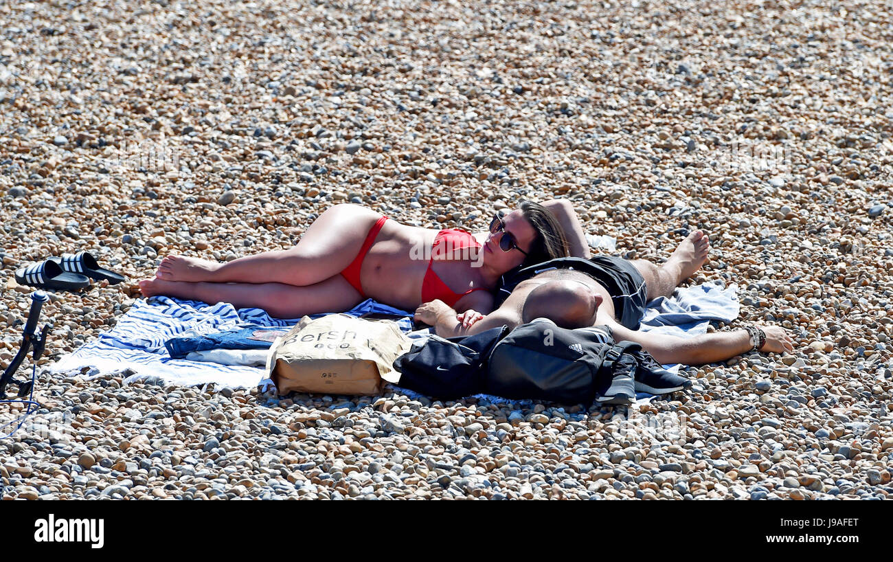 Brighton, UK. 1st June, 2017. Brighton beach is packed as flaming June begins with another hot day on the South - Stock Image